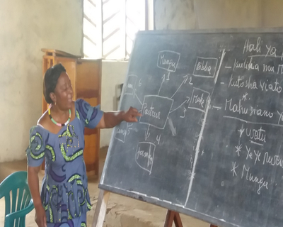 Woman Teaching in the DRC